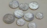 Горшок с серебряными монетами